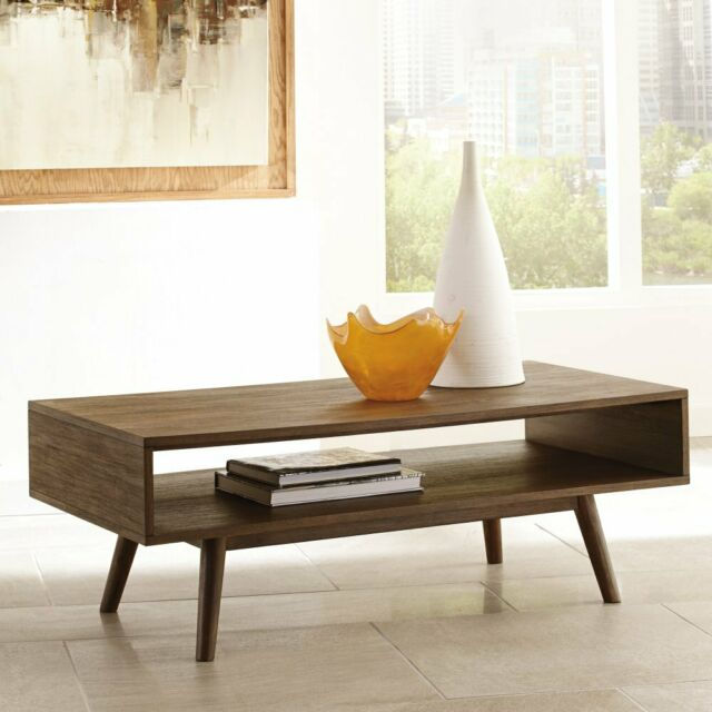 Baybrin Rustic Brown Rectangular Cocktail Table (T587-1) by Ashley .