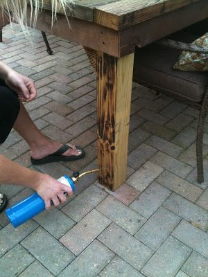 Burn wood and then stain. Ooo.. why didn't I think of that! It .
