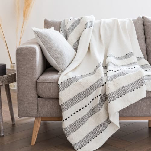 Ecru Fringed Cotton Throw with Black and Grey Graphic Motifs .