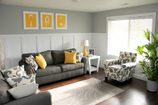 11 charcoal grey sofa and chair, yellow pillows and art pieces .