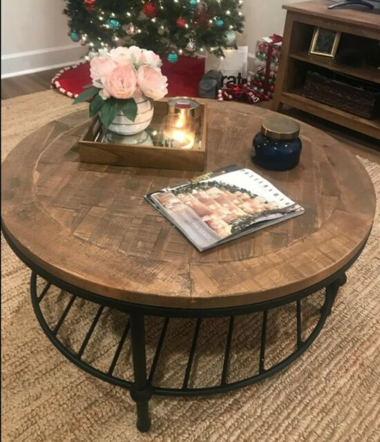 Round Coffee Table with Caster Wheels and UniqueTextured Surface .