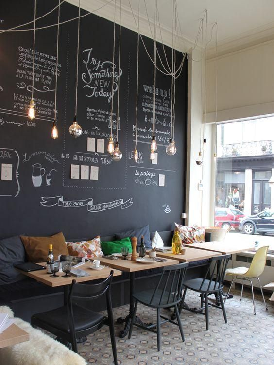 Modern and cheerful coffee shop decor with a chalkboard wa .