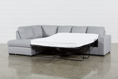 Lucy Grey 2 Piece Sleeper Sectional With Left Arm Facing Chaise .