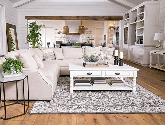 country/rustic dining room with Magnolia Home Homestead sofa .