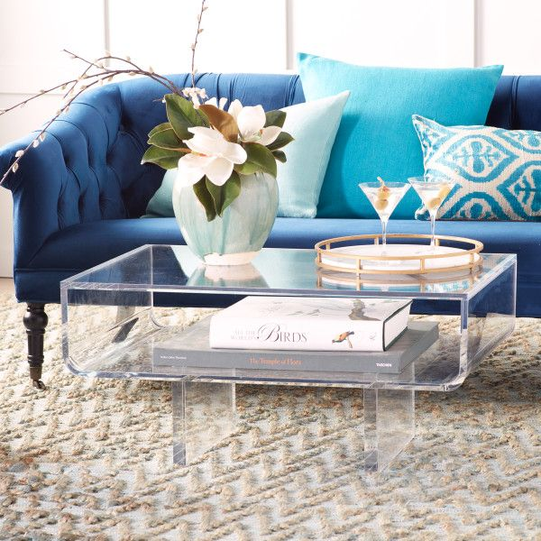 The Modern Acrylic Coffee Table features an expansive table top .