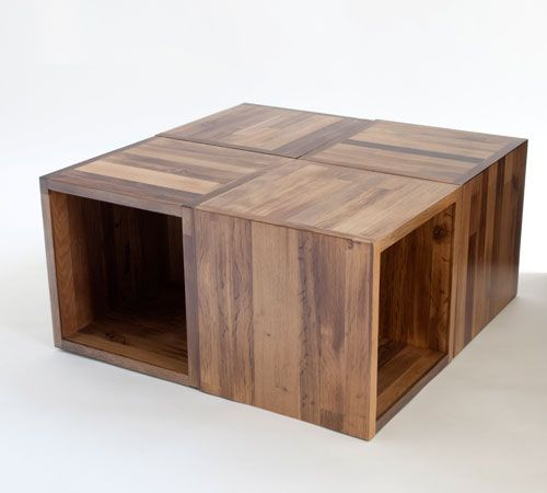 Lodenofen fireplace with textile surface   Wooden coffee table .