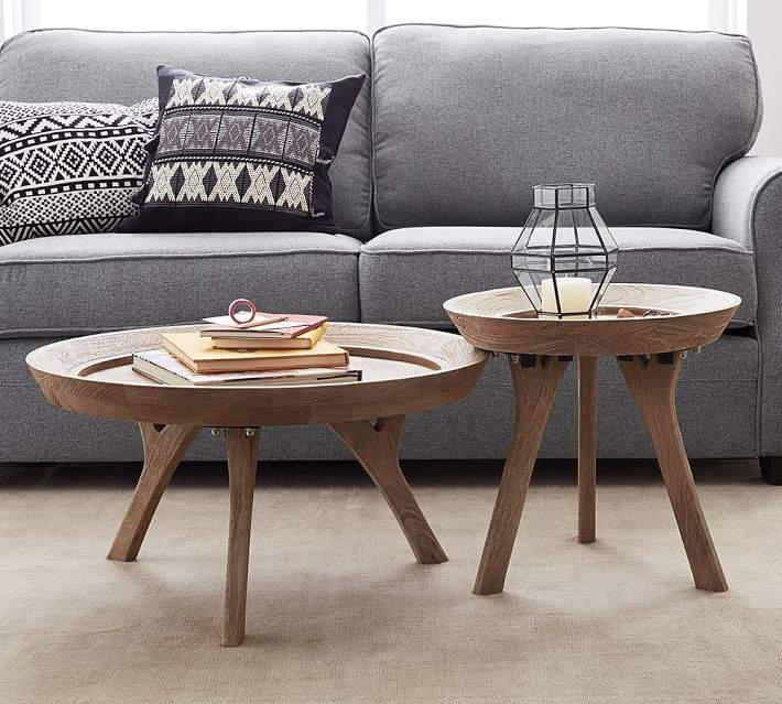 Be different and add multiple sized coffee tables to your living .