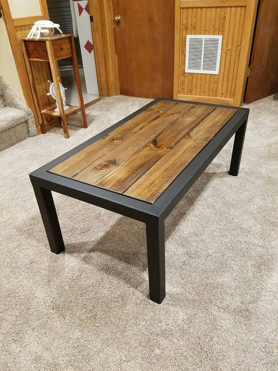 Hand made coffee table with a flat black finish. The top is a .