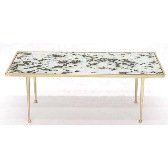 Small Italian Rectangular Coffee Table on Brass Legs Mirrored Top .