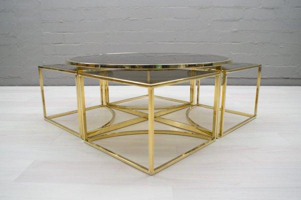 Hollywood Regency Brass & Smoked Glass Nesting Coffee Table Set .