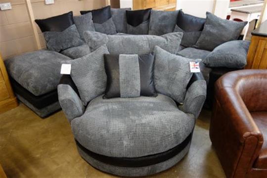 A Dino black fabric corner sofa and Dina black fabric swivel chair .