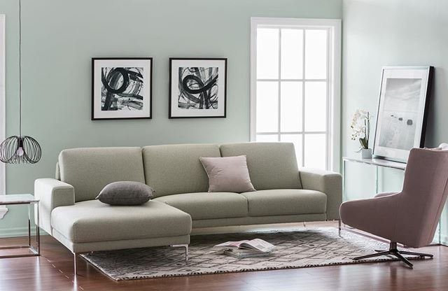 The sleek profile of this tuxedo style sectional is ideal for home .