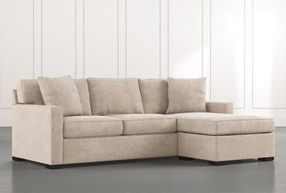 Taren II Beige Reversible Sofa/Chaise Sleeper W/Storage Ottoman .