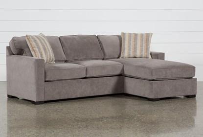 Taren II Reversible Sofa/Chaise Sleeper With Storage Ottoman .