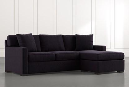 Taren II Black Reversible Sofa/Chaise Sleeper W/Storage Ottoman .
