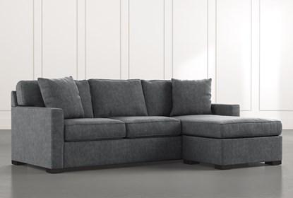 Taren II Dark Grey Reversible Sofa/Chaise Sleeper W/Storage .