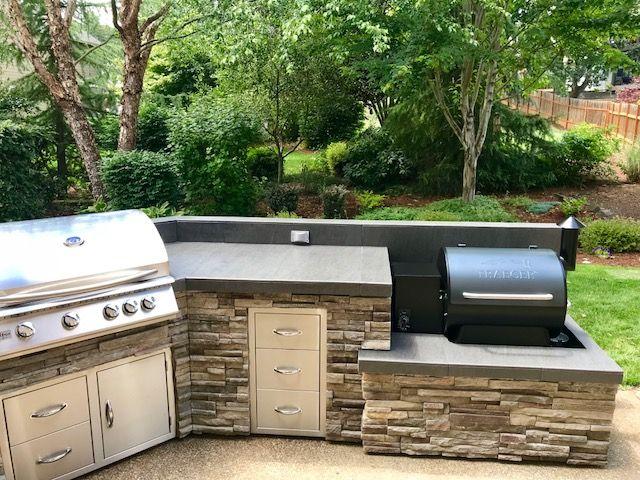 Traeger smoker outdoor kitchen by Sunset Outdoor Living, LLC .
