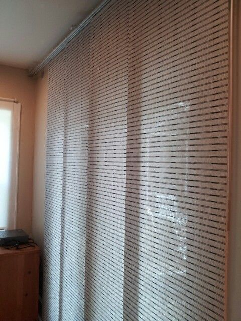 Ikea curtain covering french doors. Much better than verical .