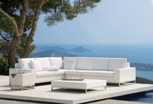Utilise the outdoor space by fixing contemporary outdoor furniture .