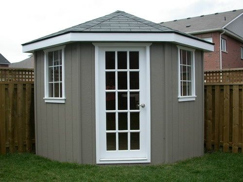 DIY corner shed. exchange the white trim for teal! sooo pretty .