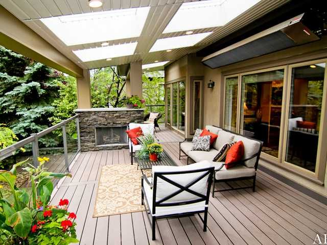 Amazing outdoor space with covered deck including skylights, gas .