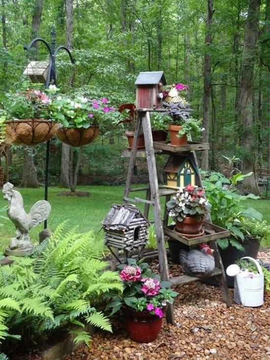 Rustic - Farmhouse DIY garden decoration with old wooden ladders .