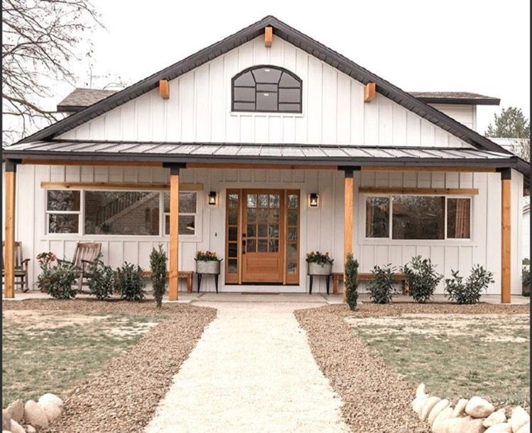 Love the black accents on the porch poles! | Barn house plans .