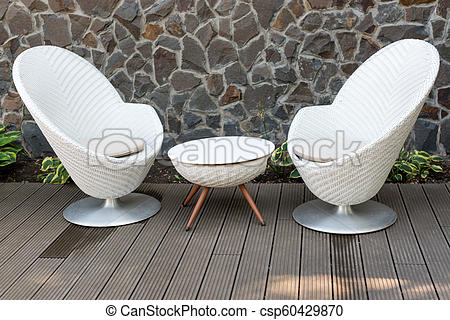Modern white armchairs and table, modern garden furniture. cozy .