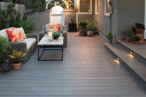 Decking, bedded plants, garden room for modern outdoor living spac
