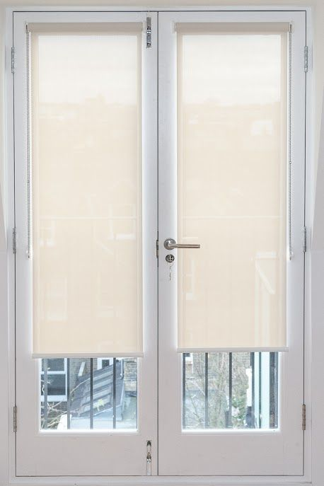 Sunscreen roller blinds fitted to french doors. #rollershades .