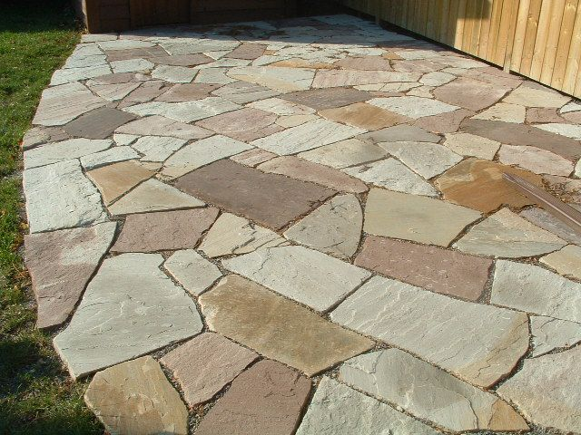 7 Patio Flooring Ideas | Patio stones, Flat stone patio, Stone .