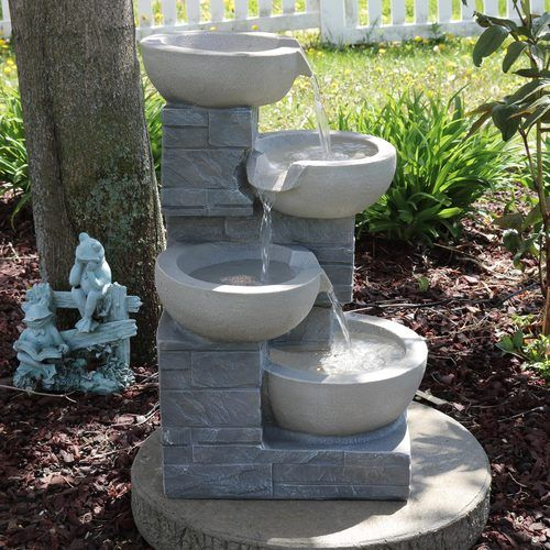 Serenity Health's outdoor backyard water fountains & outdoor patio .