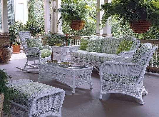 Coastal white wicker patio furniture set with matching coffee .